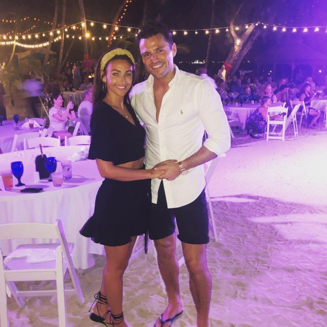 Michelle Keegan on the beach with Mark Wright
