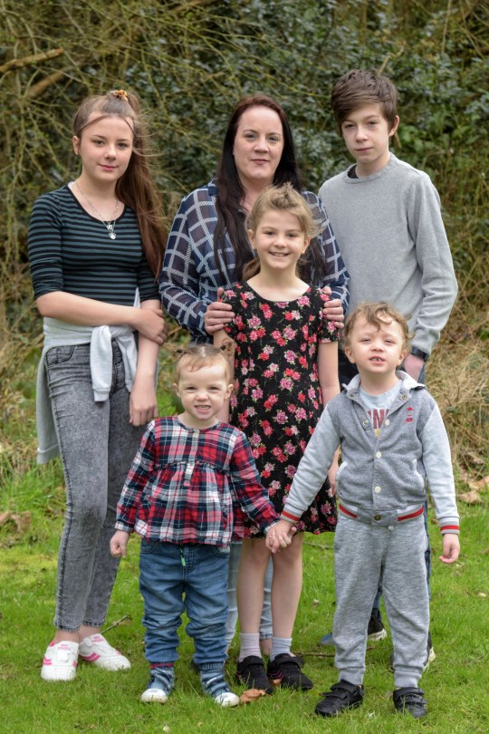 Pic by Michael Scott/Caters News - (PICTURED: Mother Cheryll Dodd, 37 from Telford with her 5 children (L-R) Ellie-Jayne Dodd-Sutton,13, Elizabeth-Ann Hopkins, 2, Annabelle Dodd-Sutton, 9, Harry Dodd-Sutton, 14 and Freddie Hopkins, 4. Cheryll was told at the age of 19 she would be unable to have kids. Pic taken: 16/03/2019)- A supermum has given birth to five miracle babies completely naturally despite doctors telling her she was 100 per cent infertile. Single mum-of-five Cheryl Dodd, 37, was only 19 when she was diagnosed with a severe case of Polycystic Ovaria Syndrome (PCOS) a condition which causes difficulty in conceiving and in some cases infertility. Doctors told her she would never be able to conceive naturally due to the cysts on her ovaries and tablets she was prescribed to stimulate egg production not working.SEE CATERS COPY