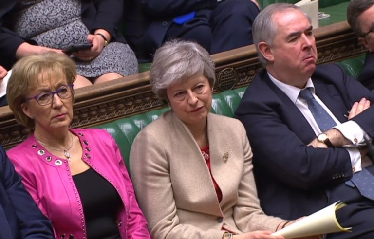 "A video grab from footage broadcast by the UK Parliament's Parliamentary Recording Unit (PRU) shows Britain's Leader of the House of Commons Andrea Leadsom (L), Britain's Prime Minister Theresa May (C) and Britain's Attorney General Geoffrey Cox listen as Deputy leader of the Democratic Unionist Party (DUP) Nigel Dodds (unseen) speaks in the House of Commons in London on March 29, 2019, during a debate the Government's Withdrawal Agreement ahead of a vote on it today. - MPs are set for a momentous third vote Friday on Prime Minister Theresa May's Brexit divorce deal, which could end a months-long crisis or risk Britain crashing out of the EU in two weeks. The House of Commons has twice rejected May's withdrawal agreement, both times by large margins, but has been unable to agree any alternative -- and time is running out. (Photo by - / PRU / AFP) / RESTRICTED TO EDITORIAL USE - MANDATORY CREDIT "" AFP PHOTO / PRU "" - NO USE FOR ENTERTAINMENT, SATIRICAL, MARKETING OR ADVERTISING CAMPAIGNS - EDITORS NOTE THE IMAGE HAS BEEN DIGITALLY ALTERED AT SOURCE TO OBSCURE VISIBLE DOCUMENTS-/AFP/Getty Images"