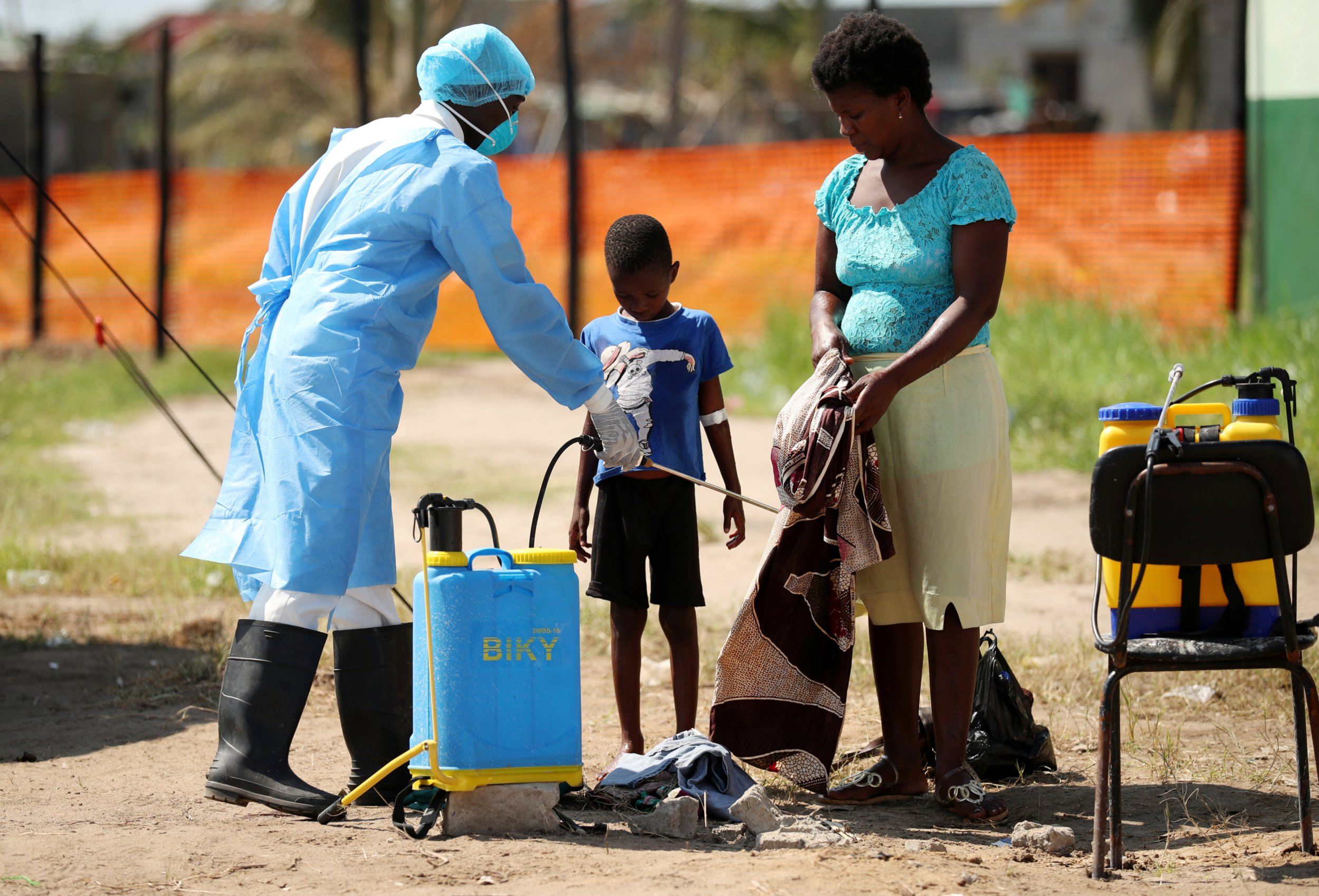 Medical staff spray disinfectant at a cholera treatment centre set up in the aftermath of Cyclone Idai in Beira, Mozambique, March 29, 2019. REUTERS/Mike Hutchings