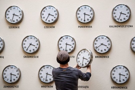 epaselect epa07471219 Kamil R. Filipowski changes the batteries and changes the hands of the clocks being part of the artistic installation 'Time for culture' at the Center of Culture in Lublin, Poland, 29 March 2019. At night between 30 March and 31 March, Polish clocks will be switched back to summer time. The clock tips will move one hour forward, from 2:00 to 3:00. EPA/WOJCIECH PACEWICZ POLAND OUT