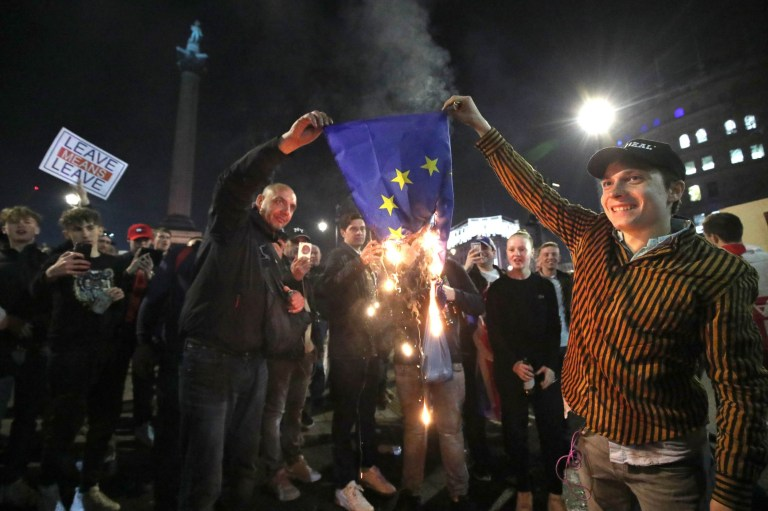 Pro-Brexit supporters burn a EU flag near to Trafalgar Square in central London, following the March to Leave protest. PRESS ASSOCIATION Photo. Picture date: Friday March 29, 2019. See PA story POLITICS Brexit. Photo credit should read: Yui Mok/PA Wire