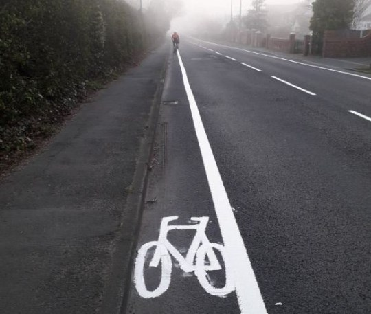 A cyclist has mocked a ?new? cycle lane which was painted on a busy road in Wigan - claiming it isn?t even wide enough to accommodate his shoulders. The lane has been freshly painted on Newton Road, in Lowton, and has prompted ridicule from the borough?s cycling community. The 'refreshed' cycle lane was spotted on Friday morning