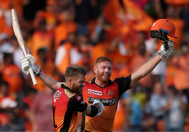 Sunrisers Hyderabad's David Warner, left, greets Jonny Bairstow on scoring hundred runs against Royal Challengers Bangalore during the VIVO IPL T20 cricket match in Hyderabad, India, Sunday, March 31, 2019. (AP Photo/ Mahesh Kumar A.)