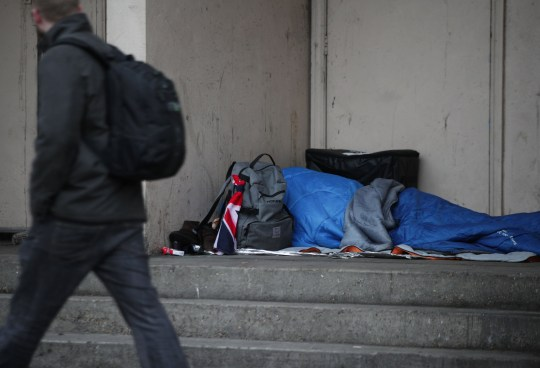"Embargoed to 0001 Wednesday December 05 File photo dated 07/02/17 of a person sleeping rough in a doorway. Shelter has warned the UK's housing crisis will be ""felt across a generation"" as the latest figures reveal the scale of children living in homelessness PRESS ASSOCIATION Photo. Issue date: Wednesday December 5, 2018. The charity urged the public to support its Christmas appeal which aims to provide families with ""the vital helpline advice and services they need in order to keep their homes over the festive period"". See PA story SOCIAL Homeless. Photo credit should read: Yui Mok/PA Wire"