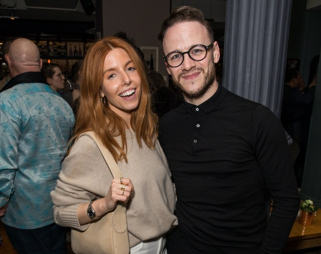 Stacey Dooley and Kevin Clifton posing for a photo together