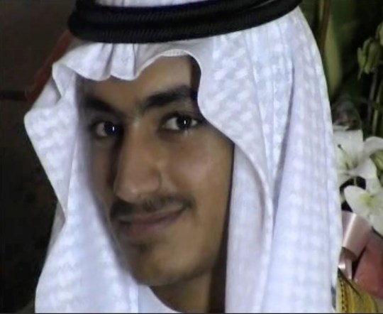 "An undated file video grab released by the Central Intelligence Agency (CIA) on November 1, 2017 and taken by researchers from the Federation for Defense of Democracies' Long War Journal, shows an image from the wedding of killed Al-Qaeda leader Osama Bin Laden's son Hamza. - The CIA has put online 470,000 additional files seized in May 2011 when US Navy SEALs burst into the Abbottabad compound and shot dead the leader of Al-Qaeda's global extremist network. According to Thomas Joscelyn and Bill Roggio, scholars from the Foundation for Defense of Democracies who were allowed to study the trove before it was made public, it provides new insights. ""These documents will go a long way to help fill in some of the blanks we still have about al Qaeda's leadership,"" Roggio said. The inclusion of Hamza Bin Laden's wedding video, for example, gives the world public the first image of Bin Laden's favorite son as an adult -- an image apparently shot in Iran. (Photo by Handout / FEDERATION FOR DEFENSE OF DEMOCRACIES / AFP) / RESTRICTED TO EDITORIAL USE - MANDATORY CREDIT ""AFP PHOTO / FEDERATION FOR DEFENSE OF DEMOCRACIES' LONG WAR JOURNAL"" - NO MARKETING NO ADVERTISING CAMPAIGNS - DISTRIBUTED AS A SERVICE TO CLIENTS == TO GO WITH AFP STORY by Dave Clark ""US-ATTACKS-QAEDA-SPY-PAKISTAN-IRAN"" / HANDOUT/AFP/Getty Images"