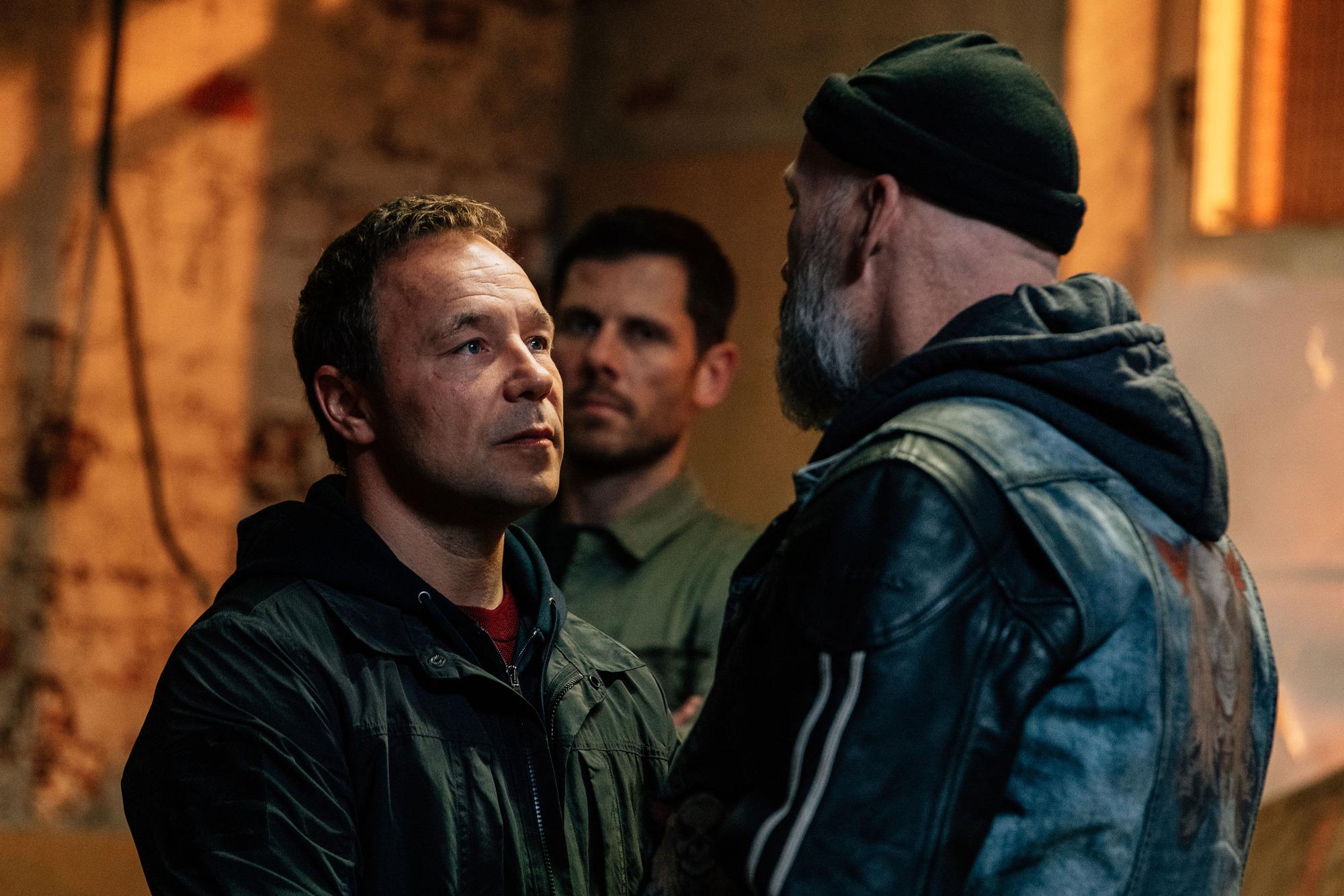 Balaclava Man Corbett (Stephen Graham) talks to Lee (Alastair Natkiel) and Slater (Barry Aird) on Line Of Duty