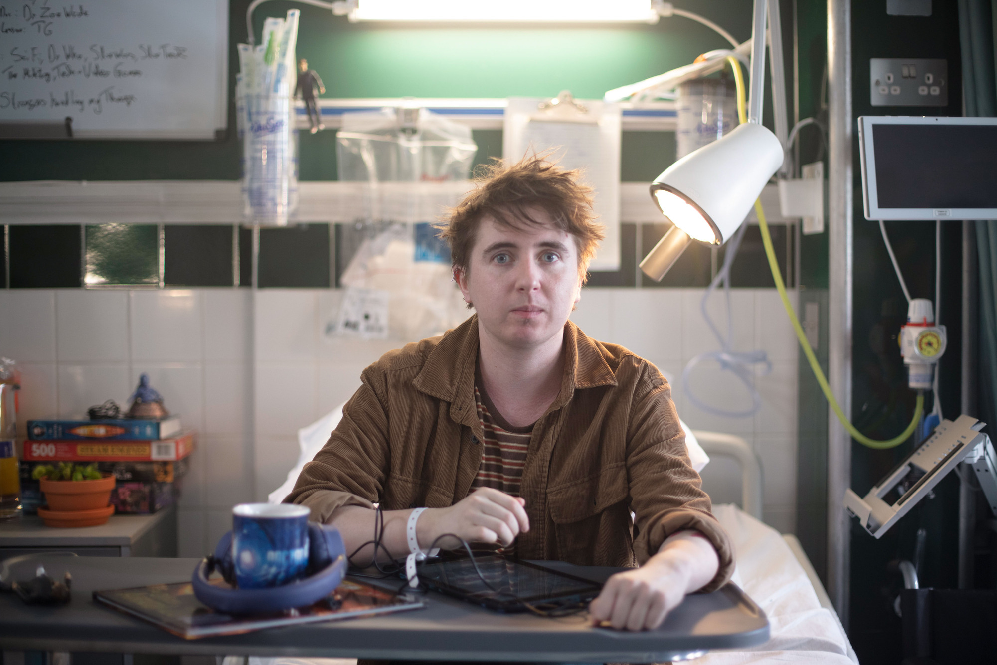 Trust Me star Elliot Cooper as Danny in his hospital ward with Doctor Who memorabilia