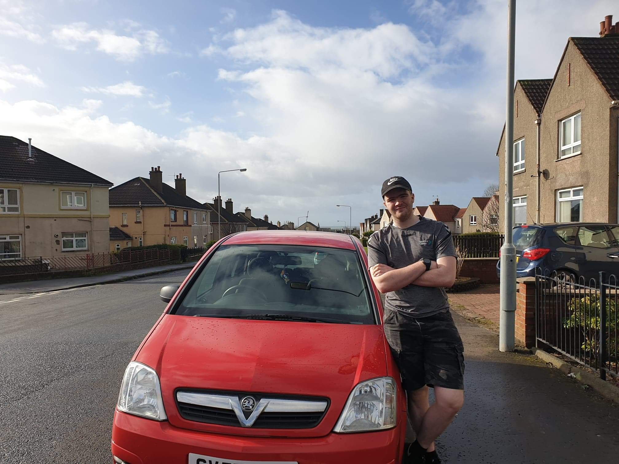 Billy Mair poses with his car