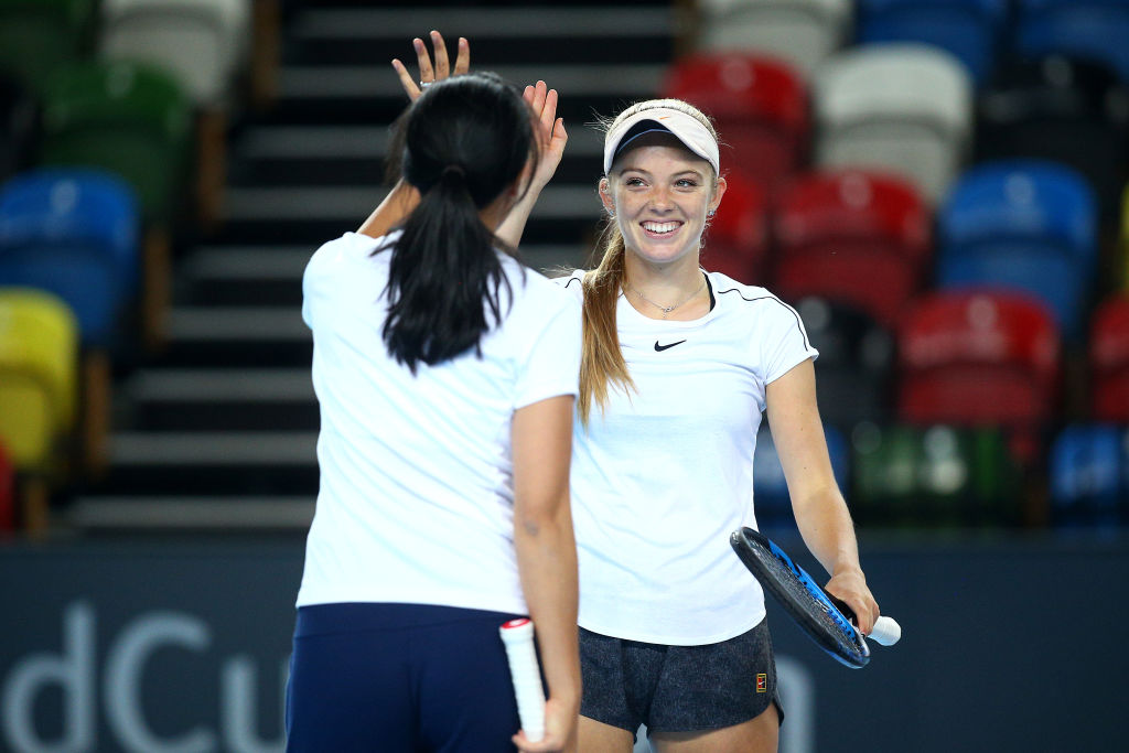 Katie Swan high-fiving Anne Keothavong