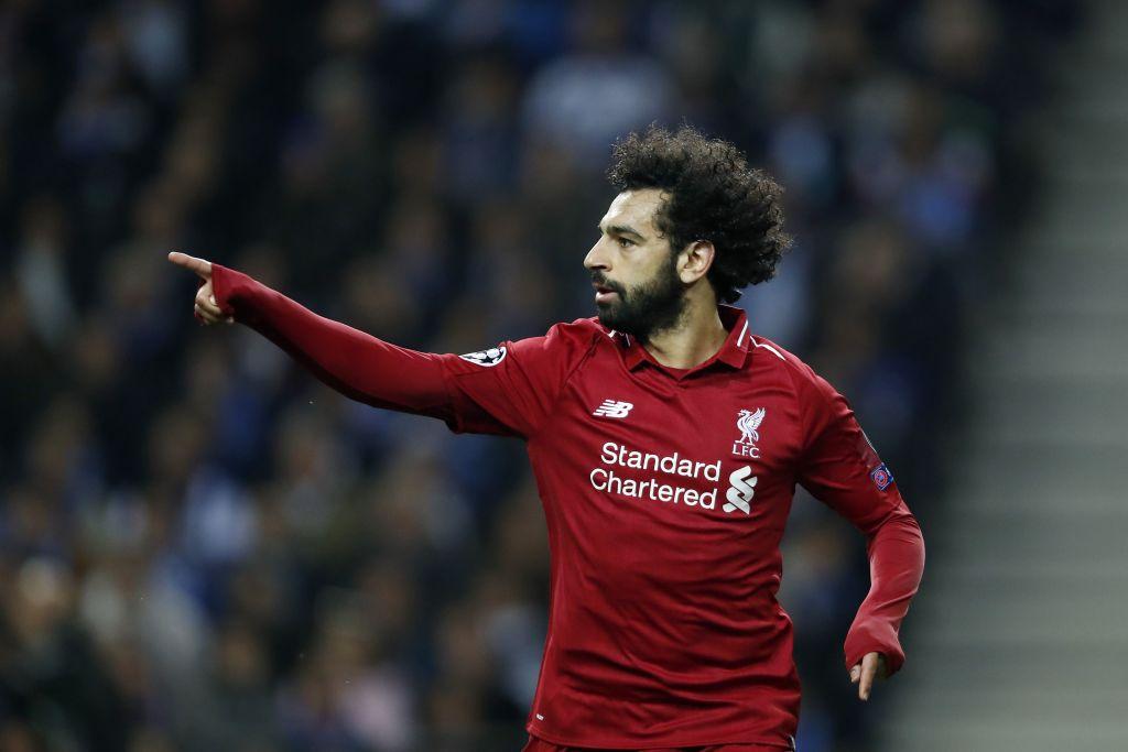 Virgil van Dijk celebrates Mohamed Salah's goal against Porto before he's even taken his shot