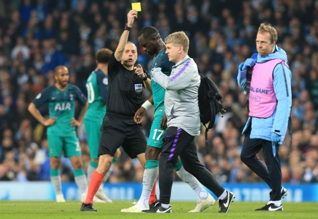 Tottenham's Moussa Sissoko was booked as he went off injured against Manchester City