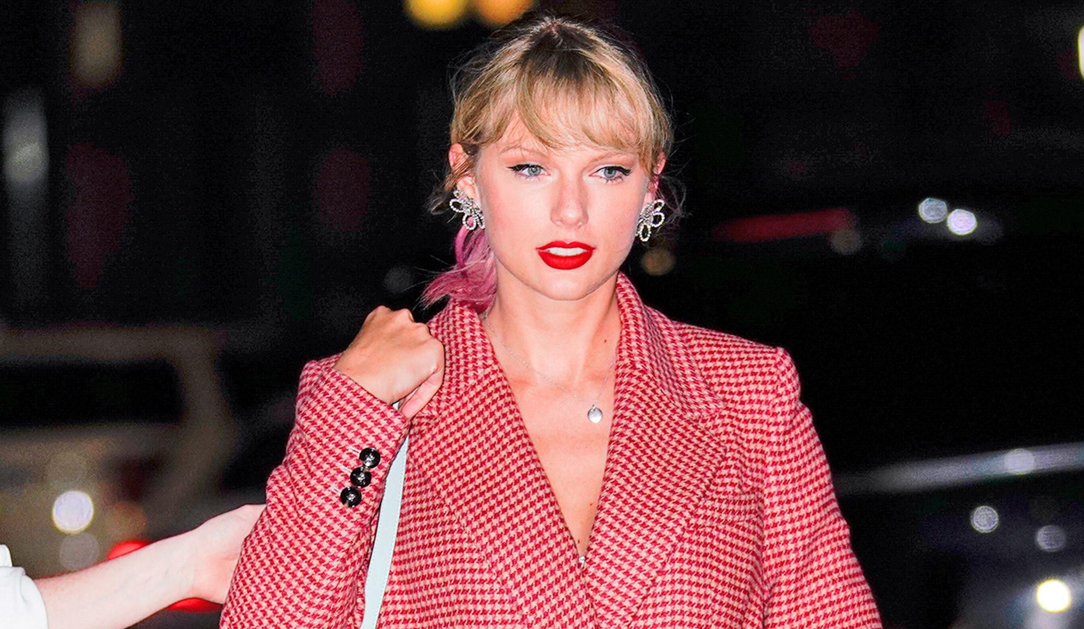 Taylor Swift attends Gigi Hadid's denim themed birthday party in floral dress