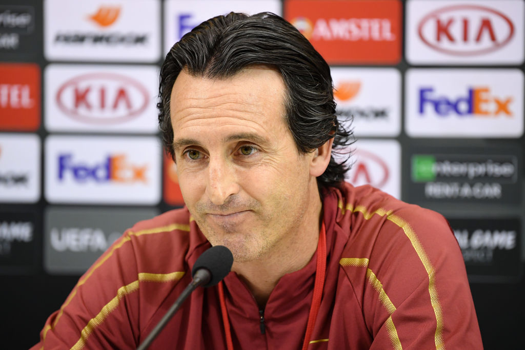 Unai Emery answers questions at a press conference