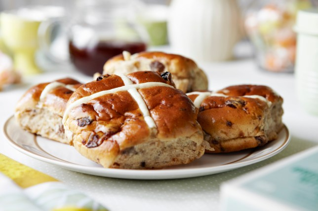 Why do we eat hot cross buns at Easter and what is the cross on a hot cross bun made of?