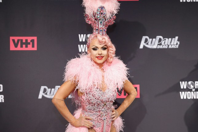 Farrah Moan from Drag Race in a pink showgirl outfit