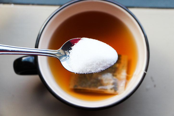 A spoonful of sugar over a cup of tea