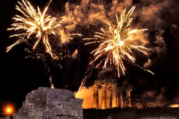 Fireworks exploding over the archaeological temple of Apollo in ancient Corinth near Athens to celebrate Orthodox Easter