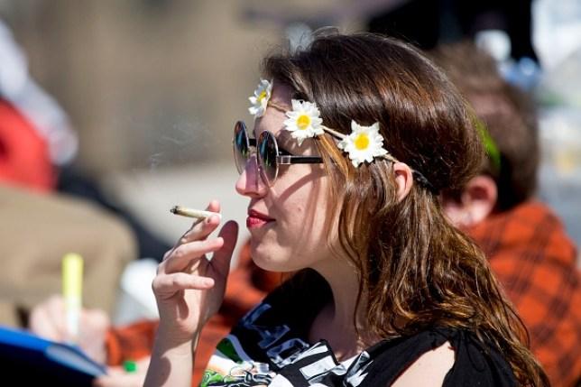 woman smoking cannabis to celebrate 420 day