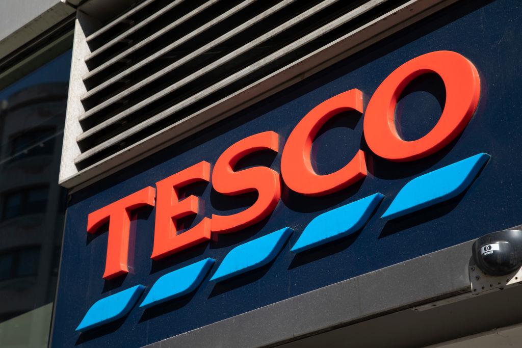 Tesco Express supermarket store logo in London