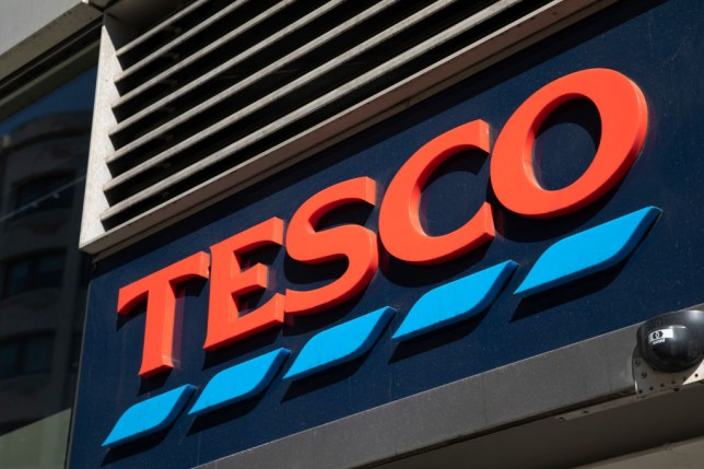 Tesco Express supermarket store logo in London