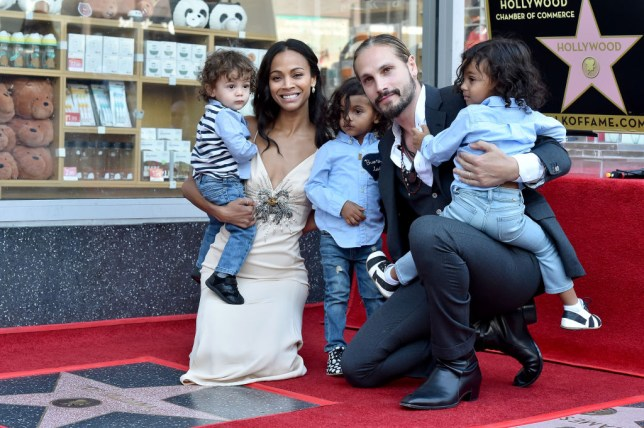 Zoe Saldana pictured with husband Marco Perego Saldana and their sons Cy, Bowie and Zen.