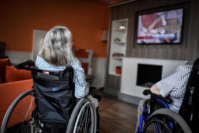 Elderly people watching TV