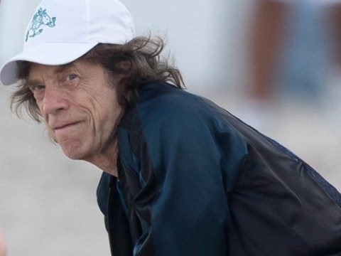 Mick Jagger pictured recuperating on beach as he postpones Rolling Stones tour due to mysterious illness