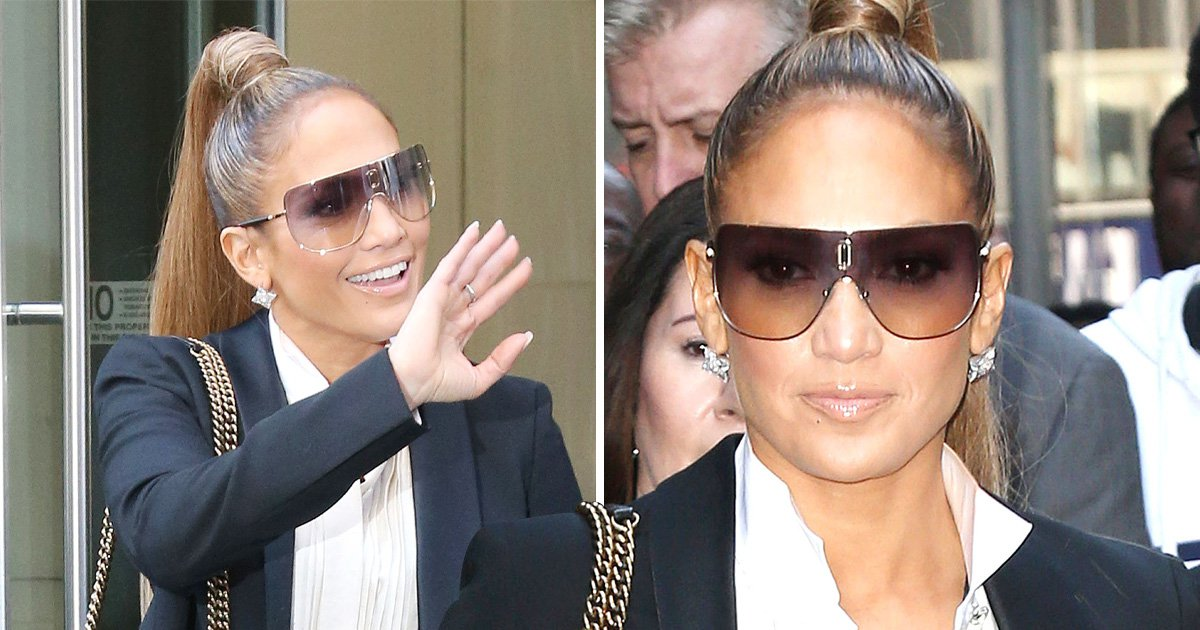 Jennifer Lopez puts away those fine abs as she suits up for a radio appearance in New York