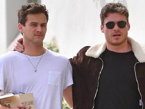 Richard Madden enjoys stroll with pal Brandon Flynn while carrying marijuana cigarettes
