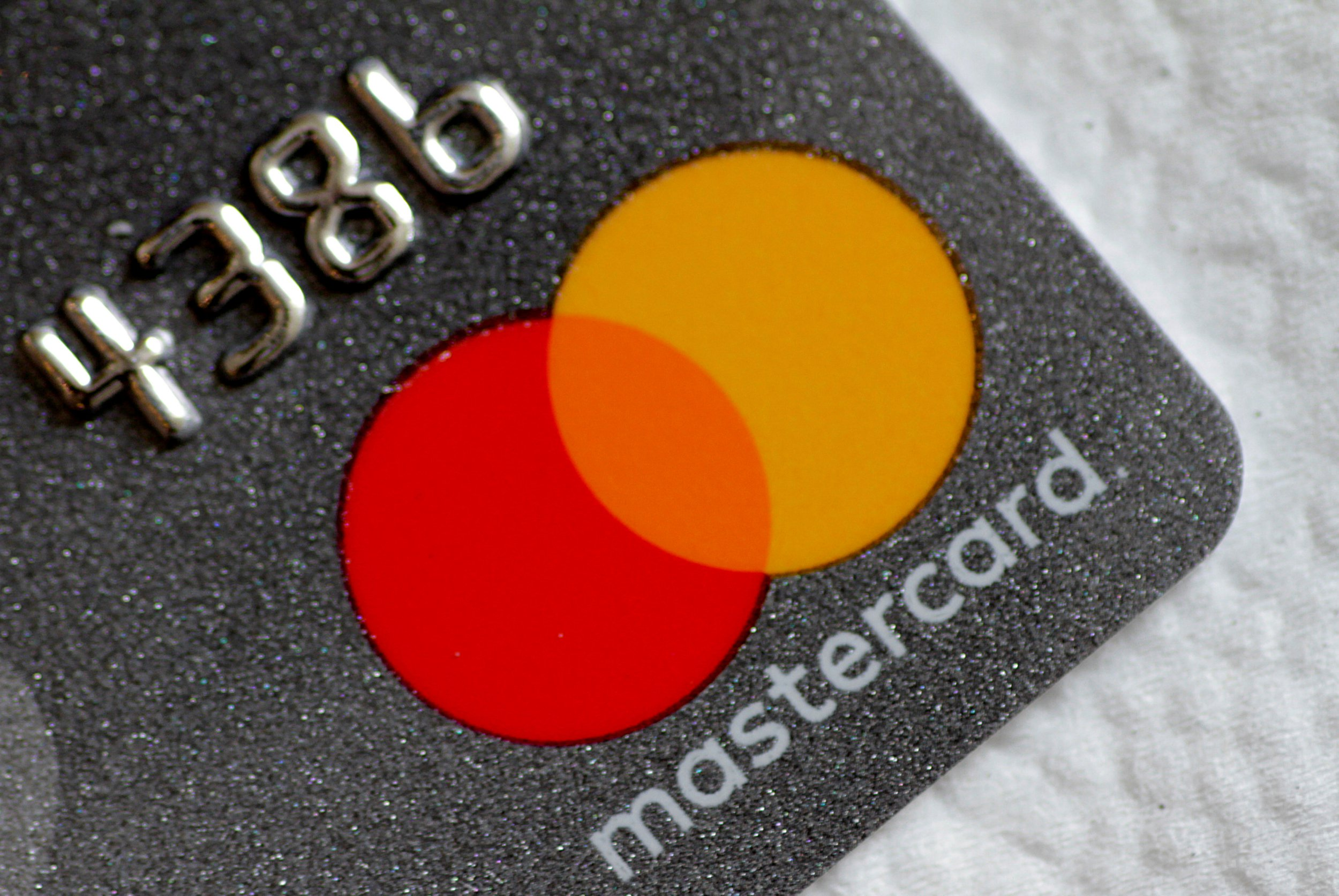 FILE PHOTO: A Mastercard logo is seen on a credit card in this picture illustration August 30, 2017. REUTERS/Thomas White/File Photo