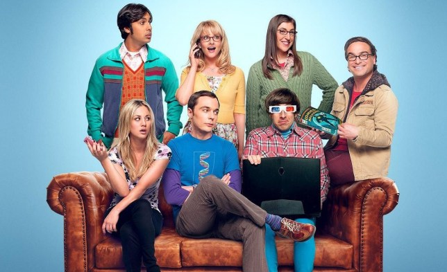 The cast of The Big Bang Theory sat on a sofa
