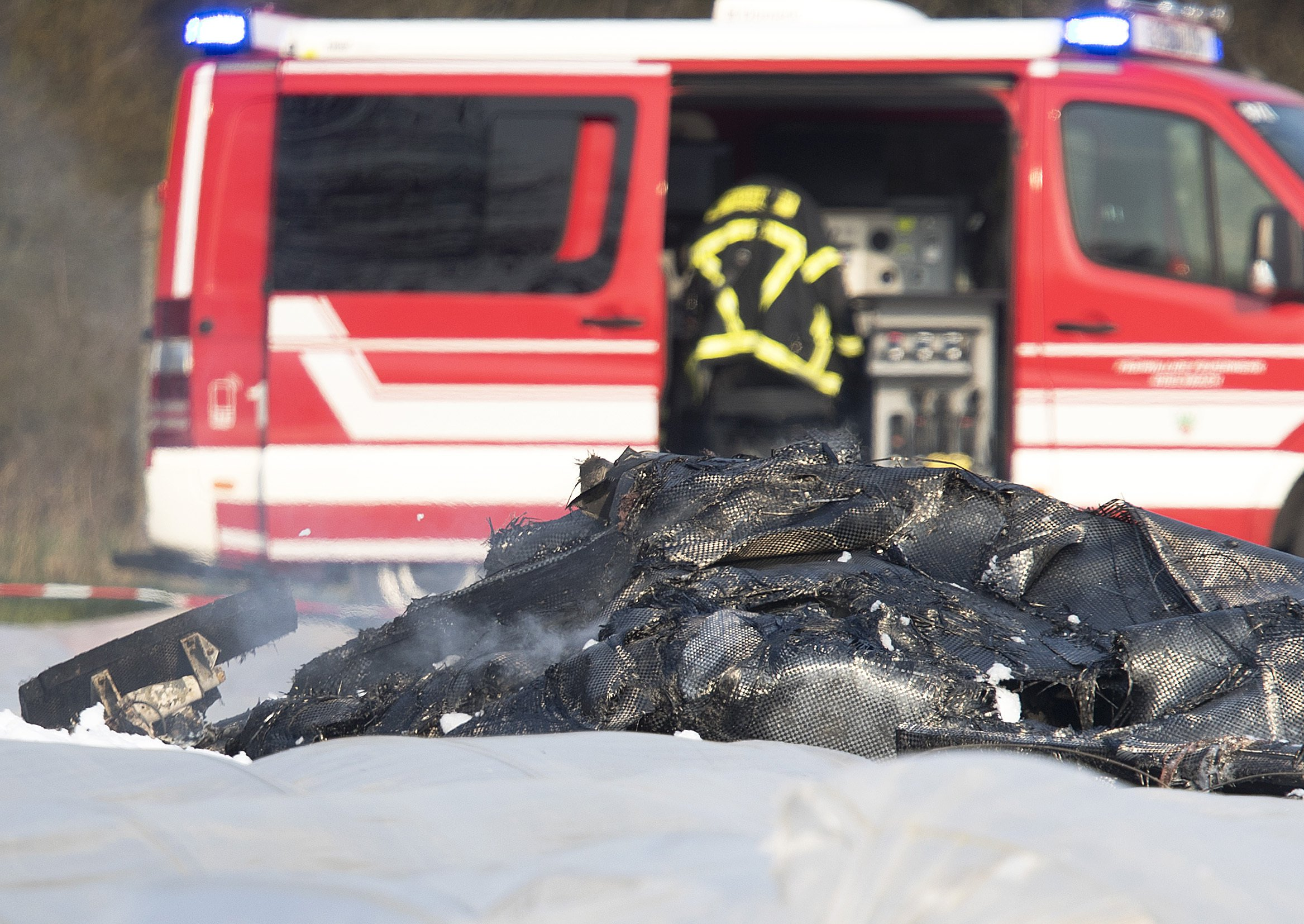 The burnt out debris of a small aircraft lies on a field near the small airport of Egelsbach bear Frankfurt, Germany, Sunday, March 31, 2019, which crashed on approach to the airport. Russian airline S7 says co-owner Natalia Fileva, one of Russia's richest women, has died in a small plane crash in Germany. (AP Photo/Michael Probst)