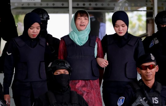 SHAH ALAM, MALAYSIA - APRIL 1 : Vietnamese Doan Thi Huong, as she smiles escorted by police after a court session for her trial at the Shah Alam High Court for murder case of Kim Jong Nam, North Korean leader Kim Jong Un's brother, on April 1, 2019 in Shah Alam, Malaysia. Malaysian prosecutors dropped a murder charge after she pleaded guilty to a lesser charge of causing harm using dangerous means. Down Thi Huong from Vietnam had been accused of killing Kim Jong Nam by smearing VX nerve agent on his face at the Kuala Lumpur International Airport 2 (klia2) in 2017. (Photo by Mohd Samsul Mohd Said/Getty Images)