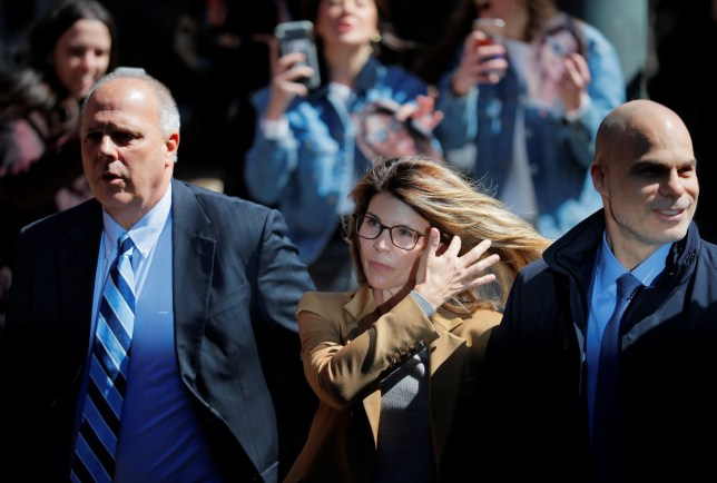 Actor Lori Loughlin, facing charges in a nationwide college admissions cheating scheme, is escorted to federal court in Boston, Massachusetts, U.S., April 3, 2019. REUTERS/Brian Snyder
