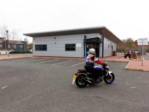 Biker died crashing into driving test centre while doing emergency stop