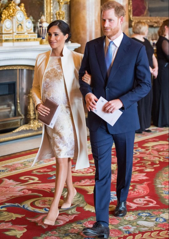 LONDON, ENGLAND - MARCH 5: Meghan, Duchess of Sussex and Prince Harry, Duke of Sussex attend a reception to mark the fiftieth anniversary of the investiture of the Prince of Wales at Buckingham Palace on March 5, 2019 in London, England. (Photo by Dominic Lipinski - WPA Pool/Getty Images)