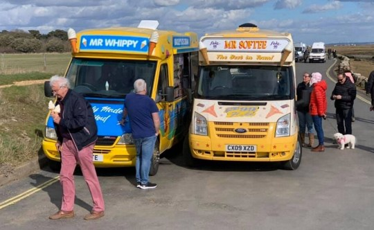 """Pictured: Debbie Head's van (right) parked to block the serving hatch of the Mr Whippy van. A seaside ice cream seller in a cold war with a rival who tried to steal her pitch stunned customers by parking her van in front of his to completely block his serving hatch. Debbie Head was given the inside scoop another vendor was using her village pitch and decided to take matters into her own hands. The 57-year-old drove her Mr Softee van to the beauty spot at Milford in the New Forest, Hants, where she has sold ice cream since 2013, and parked directly in front of her rival - completely blocking them. Despite no one being able to buy from him, the Mr Whippy van owner remained where he had parked for a further two hours before finally giving up. Mrs Head said: """"There is an unwritten rule amongst street traders that you don?t just turn up and start trading on an existing pitch. SEE OUR COPY FOR DETAILS. ? Solent News & Photo Agency UK +44 (0) 2380 458800"""