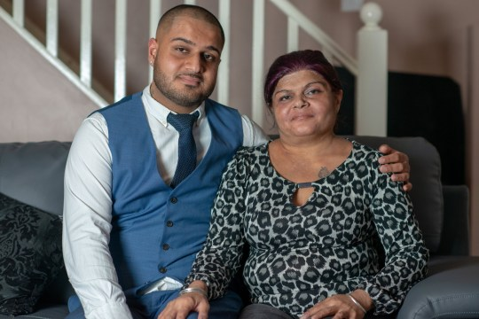 Sue Dhillon and son Dil. See SWNS copy SWTPdrug: A mum who was given weeks to live after she shunned chemotherapy has baffled doctors by treating her cancer -- with illegal super strength cannabis and Manuka honey. Susan Dhillon, 51, a mum-of-three, was diagnosed with inoperable stage four cancer of the mouth, nose and lower skull in June 2018. Doctors said unless she had chemotherapy - and then incredibly risky facial surgery - her only option was end of life care.