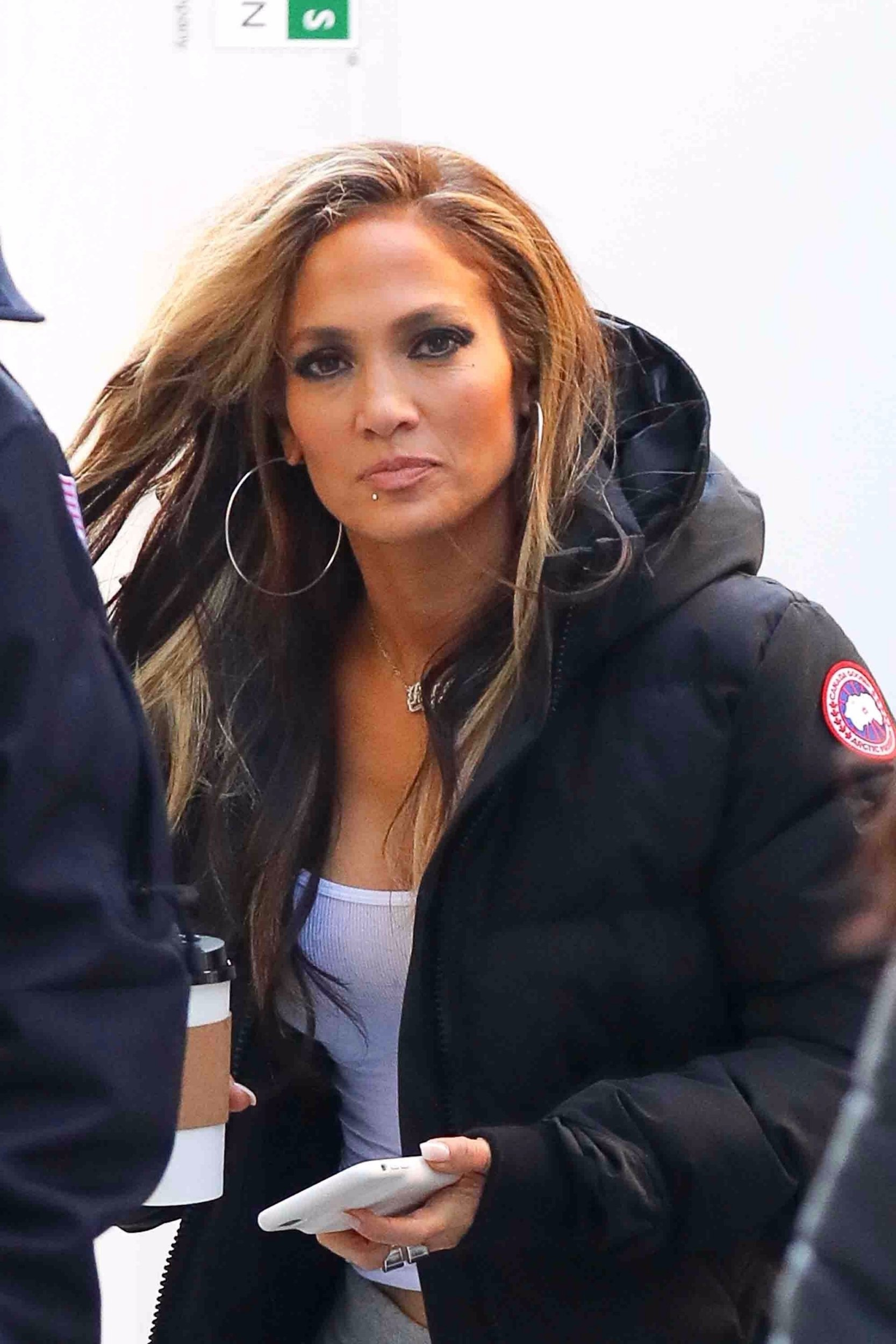 New York, NY - *EXCLUSIVE* - A smiling Jennifer Lopez arrives on the set of 'Hustlers' with a large coffee in NYC. Lopez showed off a peek of her killer abs in a crop top and grey sweats under a black puffer coat. Pictured: Jennifer Lopez BACKGRID USA 7 APRIL 2019 BYLINE MUST READ: Spartano / BACKGRID USA: +1 310 798 9111 / usasales@backgrid.com UK: +44 208 344 2007 / uksales@backgrid.com *UK Clients - Pictures Containing Children Please Pixelate Face Prior To Publication*