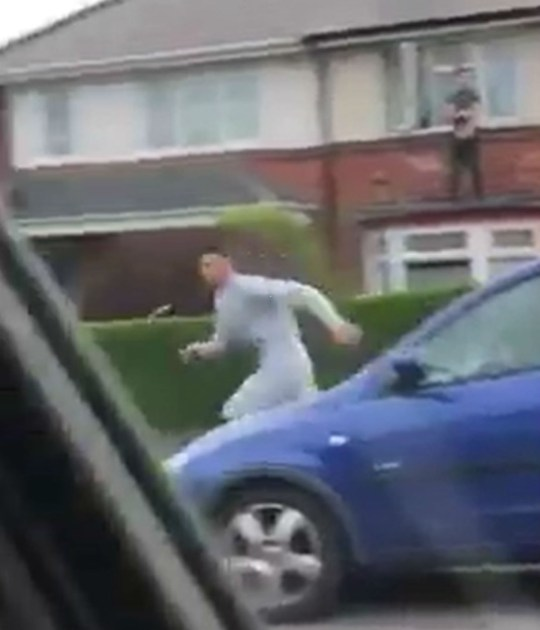"""SHOCKING video shows a couple with a baby shaking with fear as they watch men fighting in the street with knives, a hammer, bricks - and a bicycle. The clip shows a confrontation in a Birmingham street escalate into a battle as knives are drawn. The incident, believed to have been filmed yesterday (sun) in Oakhurst Road, was posted to social media with the caption: """"WTF a bit of Grand Theft Auto Birmingham style - on a Sunday.?"""