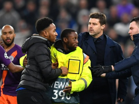 Mauricio Pochettino confronts pitch invader during Spurs' Champions League victory over Man City