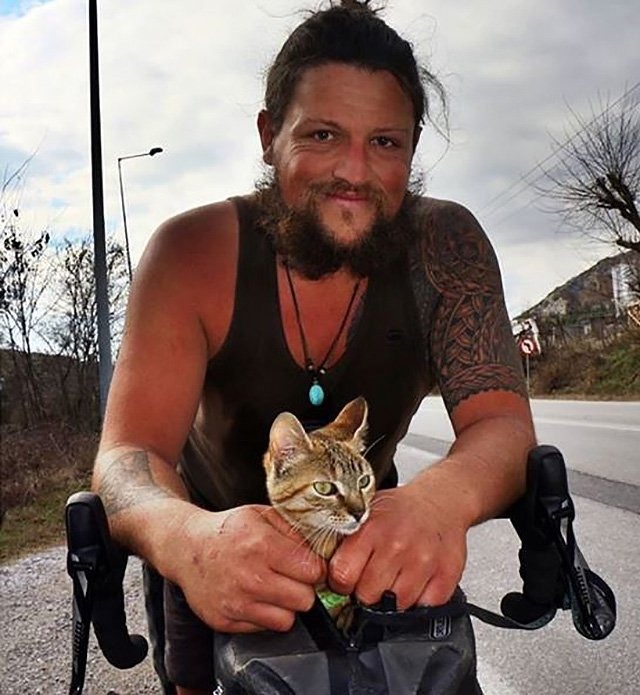 Man cycles around world with cat Picture: 1bike1world METROGRAB