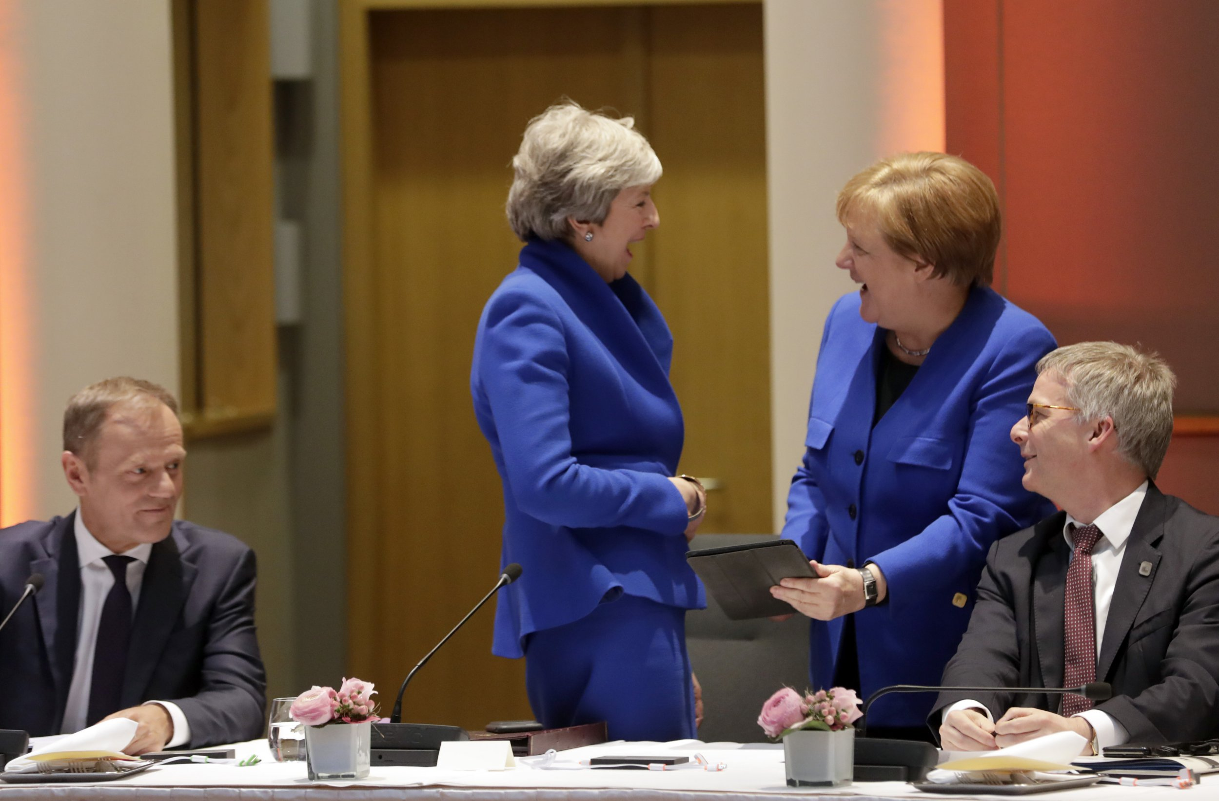 British Prime Minister Theresa May, left, speaks with German Chancellor Angela Merkel prior to a dinner during an EU summit in Brussels, Wednesday, April 10, 2019. European Union leaders met Wednesday in Brussels for an emergency summit to discuss a new Brexit extension. (Olivier Hoslet, Pool Photo via AP)