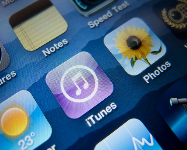 Close-up of screen of iPhone smart phone showing iTunes music app