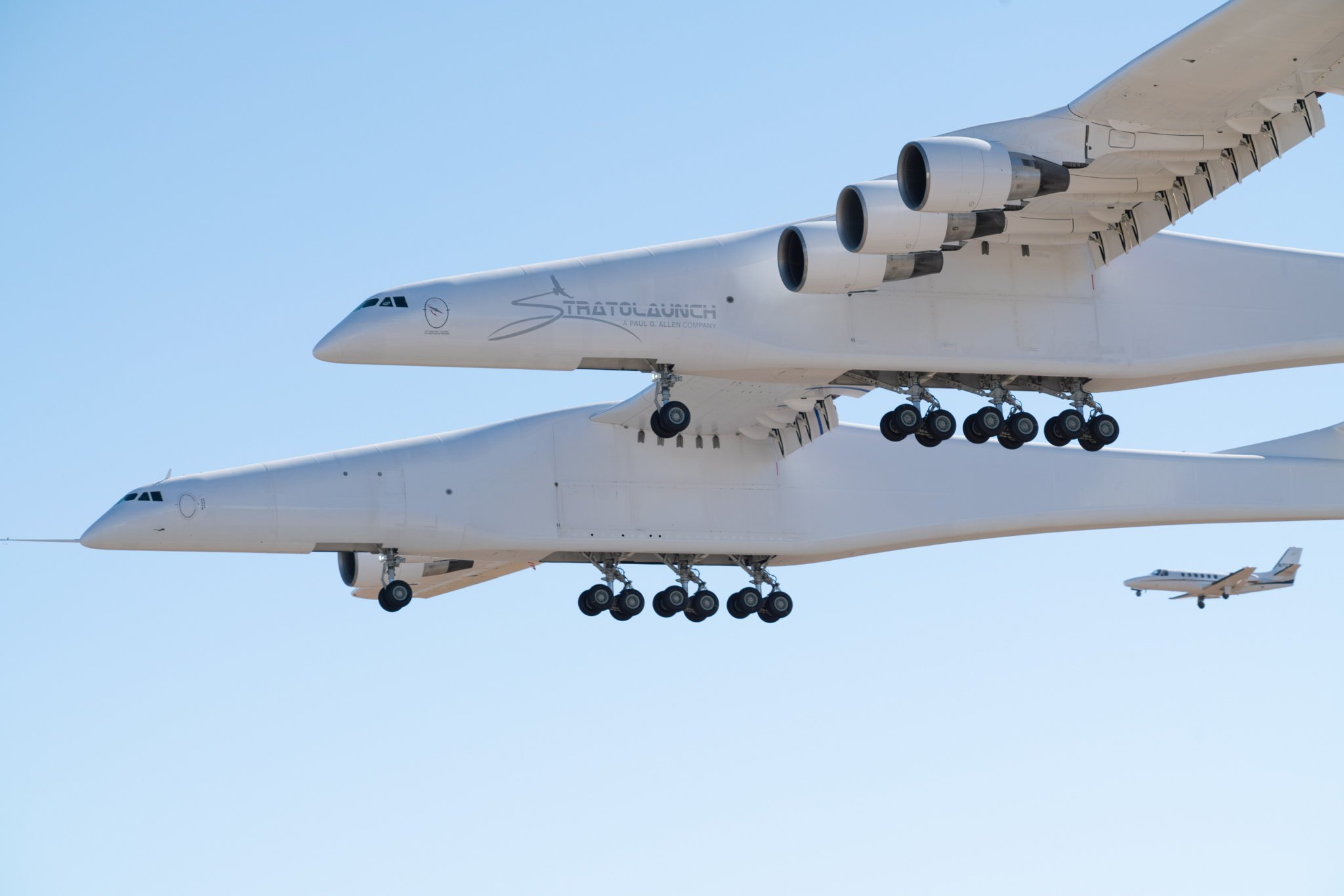 epa07505435 A handout photo made available by Stratolaunch Systems Corporation shows the Stratolaunch aircraft during a test flight over the Mojave Desert, California, USA, 13 April 2019 (issued 14 April 2019). The Stratolaunch, the world's largest aircraft by wingspan, successfully completed its first test on 13 April. The plane, which has been eight years in the making is designed to act as a flying launch pad for satellites. During the test flight it reached a maximum speed of 189 mph and flew for 2.5 hours over the Mojave Desert at altitudes up to 17,000 feet. EPA/STRATOLAUNCH HANDOUT -- MANDATORY CREDIT: STRATOLAUNCH -- HANDOUT EDITORIAL USE ONLY/NO SALES
