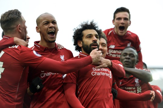 epa07506890 Liverpool's Mohamed Salah (C) celebrates with teammates after scoring the 2-0 goal during the English Premier League match between Liverpool FC and Chelsea FC at Anfield, Liverpool, Britain, 14 April 2019. EPA/PETER POWELL EDITORIAL USE ONLY. No use with unauthorized audio, video, data, fixture lists, club/league logos or 'live' services. Online in-match use limited to 120 images, no video emulation. No use in betting, games or single club/league/player publications.