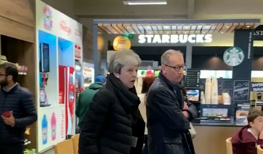 """Video grab as Prime Minister Theresa May stuns motorists as she stops off at a service station on the M54 - to go to the toilet. Shifnal, Shrops .See SWNS story SWMDtheresa. Theresa May stunned motorists after stopping at a service station on the M54 motorway for a toilet break over the weekend.The Prime Minister was snapped at the Welcome Break in Shifnal, Shrops., as it is believed she made her way to Wales for her Easter holidays.Witnesses said the ladies loos were declared """"out of bounds"""" to the public as she """"freshened up"""" for several minutes at around 12.45pm on Saturday (13/4).Delivery driver Jake Garbett, 23, said he had to double take when he spotted Mrs May walking past the shops and a Starbucks to use the toilet."""