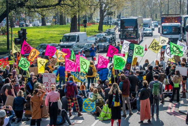 Protesters holding placards at the Extinction Rebellion climate change campaign in London